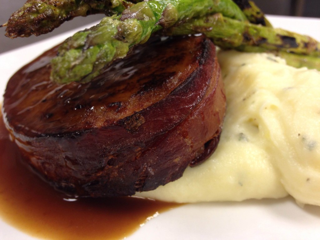 Our bacon wrapped meatloaf served with creamy white cheddar mashed potatoes and fresh grilled asparagus.